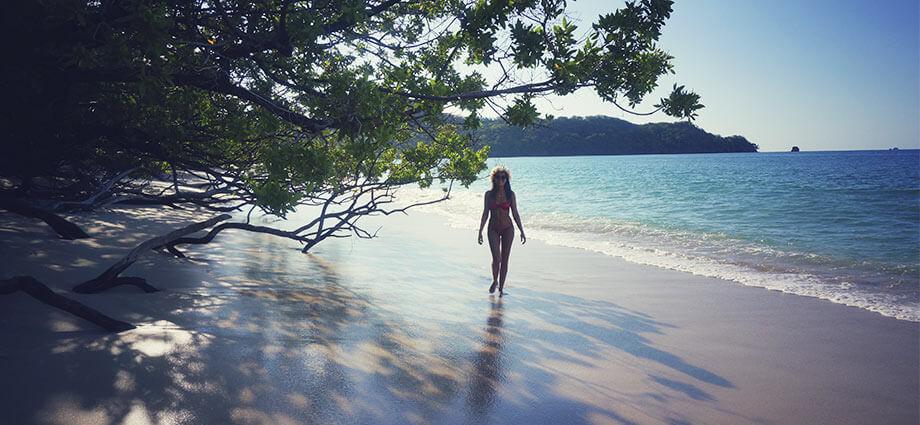 costa rica playa conchal woman walking alone