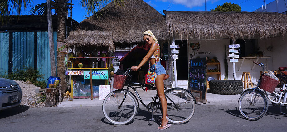 woman on a rent bike in tulum