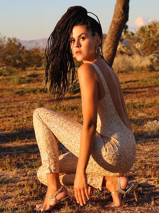 shop-desert-tribe-gazella-jumpsuit-sit-down-back-look-in-camera-hair-front