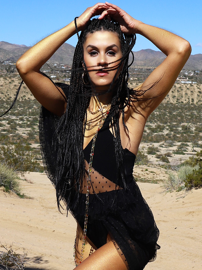 shop-desert-tribe-peacock-bodysuit-sand-look-in-camera-close-up