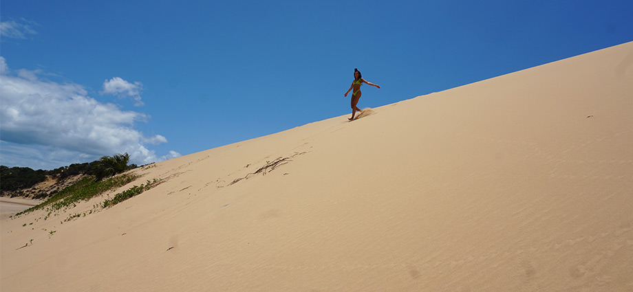 article-image-unique-islands-girl-on-sand-dune-bazaruto-island-mozambique