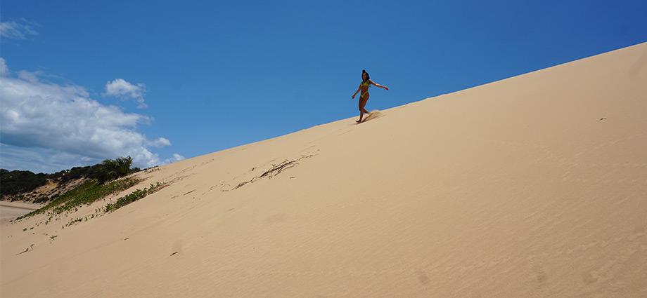 article-image-unique-islands-girl-on-sand-dune-bazaruto-island-mozambique